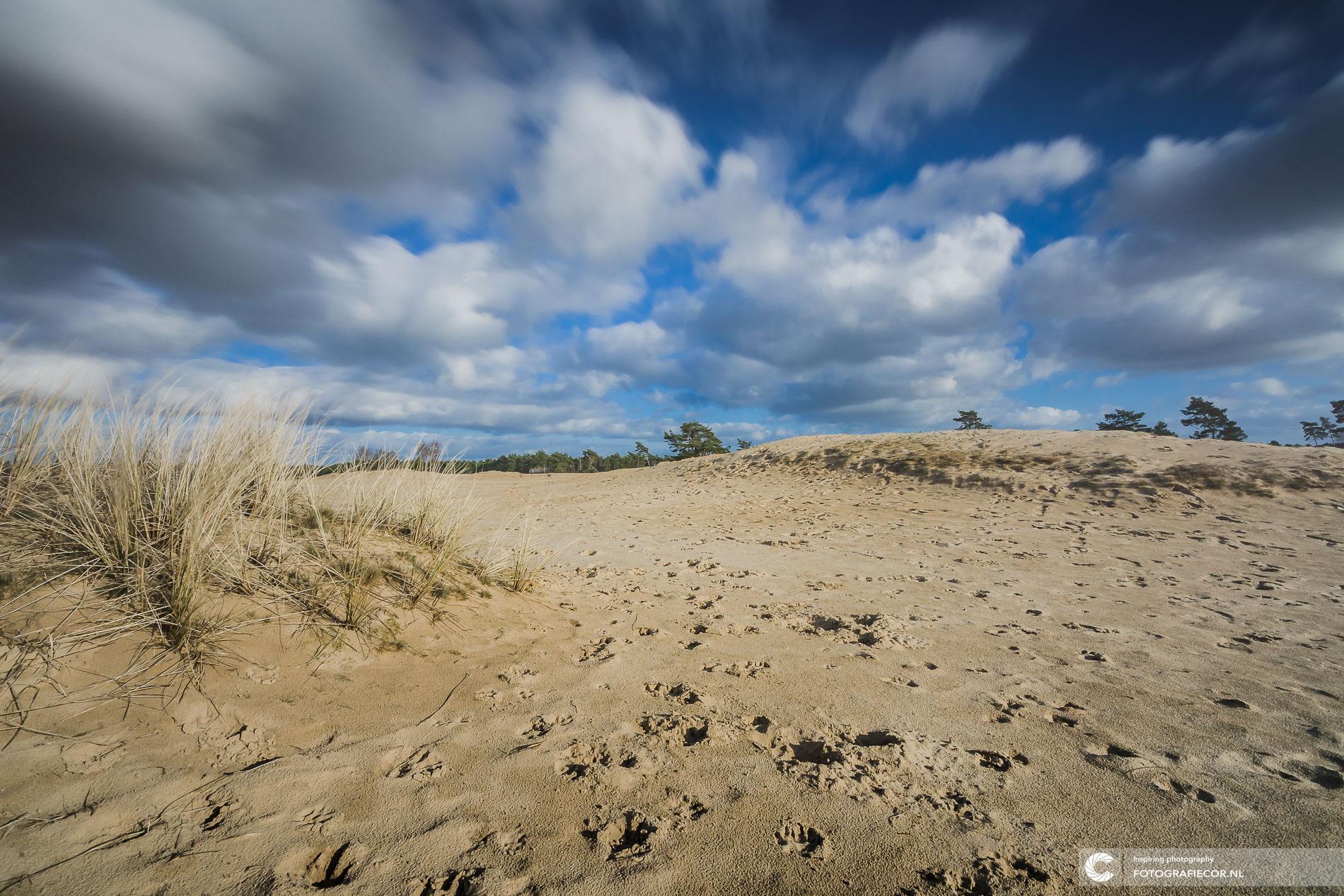 sluitertijd | witte razende wolken | Hollands landschap