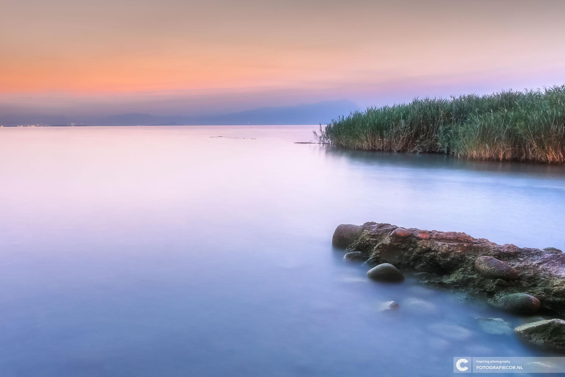 Long Exposure zonsondergang Gardameer, Italië | Landschapsfotograaf